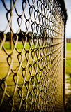 Chain Link Fence. Outfield fence at baseball park. Over this fence means a home run Stock Photo