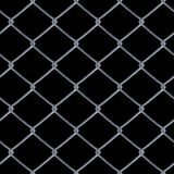 Chain Link Fence. A 3D chain link fence texture over black - this tiles seamlessly as a pattern in any direction Stock Photos