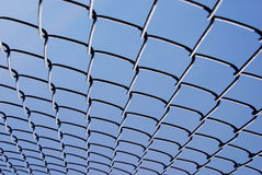 Chain Link Fence. Against a deep blue sky Stock Image