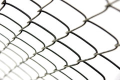 Chain-link fence. Close-up of a chain-link fence. Shallow DOF Stock Images