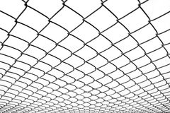 Chain-link fence. With a diminishing perspective Royalty Free Stock Photo