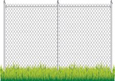 Chain link fence. Isolated chain link fence in grass Stock Photo