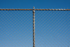 Chain link fence. Against blue sky royalty free stock image