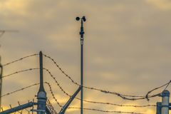 Chain link fence with barbed wire securing a Power Plant in Utah Valley royalty free stock images