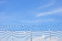 Chain link fence with barbed wire Stock Image