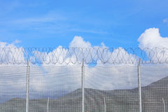 Chain link fence with barbed wire Stock Photos