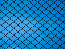 Chain link fence. With blue background Stock Image