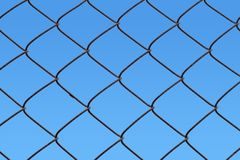 Chain link fence with blue sky. Background Stock Images