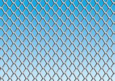 Chain link fence with blue sky background.  Royalty Free Stock Photo