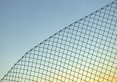 Chain link fence on blue sky Stock Photography