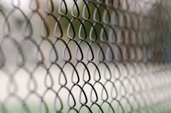 Chain link fence with blurred background. And foreground Stock Image