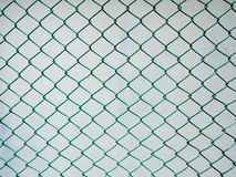 Chain Link Fence with cement wall Background Royalty Free Stock Photos