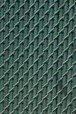 Urban Chain Link Closeup Abstract Texture Background. Chain link fence closeup abstract texture background with urban city background Stock Photography