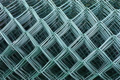 Chain link fence. Detail on roll of green chain-link fence Royalty Free Stock Photo