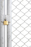 Chain link fence and metal door with lock Stock Image