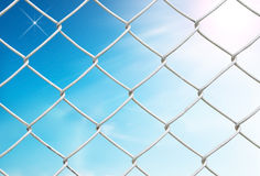 Chain link fence see blue sky Royalty Free Stock Photos