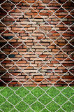 Chain link fence see grunge wall Stock Photography