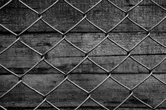 Chain link fence see old wooden background stock photos