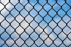 Chain link fence with sky background Royalty Free Stock Photography