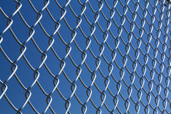 Chain Link Fence w/ Blue sky Royalty Free Stock Photography