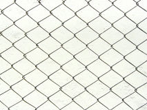 Chain link fence white metal wire mesh. Repeating chain link fence white metal wire mesh or metal net repeats left, right, up and down. The wire mesh fence close Stock Images