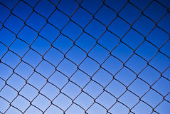Chain Link Fencing. A chain-link fence (also referred to as wire netting, chain-wire fence, cyclone fence or hurricane fence) is a type of woven fence usually Royalty Free Stock Images