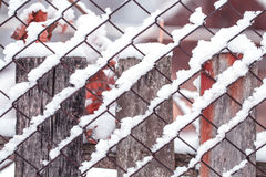 Chain-link fencing covered by snow. Stock Photos