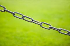 Chain Link in green background Royalty Free Stock Image
