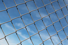 Chain Linked Fence with Blue Sky Background Stock Photo