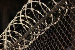 Chain linked razor wire fense Royalty Free Stock Image