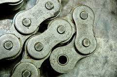 Chain Links. Links of an industrial chain. Industrial spare parts and machinery. Metal steel on aluminium work bench stock photography
