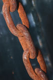 Chain Links. Rusty links on a heavy chain but still strong Stock Photos