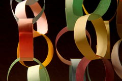 Chain and links in color harmony. Paper chain made in pastel colors Royalty Free Stock Photography
