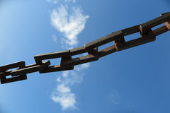 Chain links in front of a blue sky Stock Photography