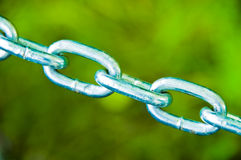 Chain Links on Green Stock Photo