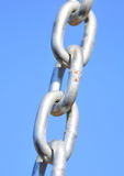 Chain Links. Shows a closeup of a metal chain link segment from a children's swing set Royalty Free Stock Photo
