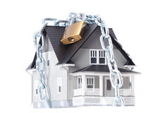 Chain with lock around the house royalty free stock photo