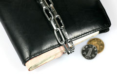Chain lock Bundle up Wallet. Depicting Cut Down Expenses Royalty Free Stock Images