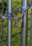 Chain and lock on a chain link fence Royalty Free Stock Photos