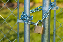 Chain and lock on a chainlink fence Stock Images