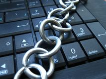 Chain and lock on laptop keyboard. Computer ban, internet ban. Addiction. Anti virus Royalty Free Stock Photography
