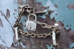 Chain and lock locked close secure gate privacy. Lock and chain on an old weathered blue door locked close closed secure gate with privacy no entry Stock Photos