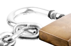 Chain and Lock. Macro shot of a chain and a big old lock isolated on white Royalty Free Stock Photos