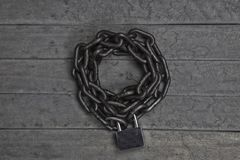 Chain with lock. On old grunge wooden background Stock Photos