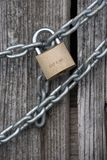 Chain lock on wooden wall. Very strong chain offer safe look together with lock on it Royalty Free Stock Image