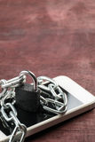 Chain locked on phone concept for security on smart phone Royalty Free Stock Photos