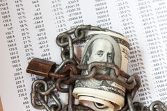 Chain locked stack of hundred dollar. Safe secure chain locked stack of hundred dollar bills Stock Photos