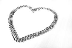 Chain Of Love. A still photo taken on a piece of chain folded and pulled into the shape of a heart. The symbol of affection - a chain of love Stock Image