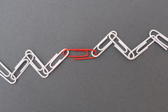 Chain made of paper clips meaning teamwork Royalty Free Stock Photography