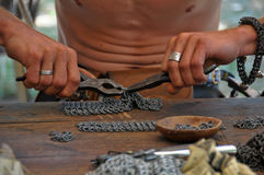 Chain-mail maker Royalty Free Stock Photo